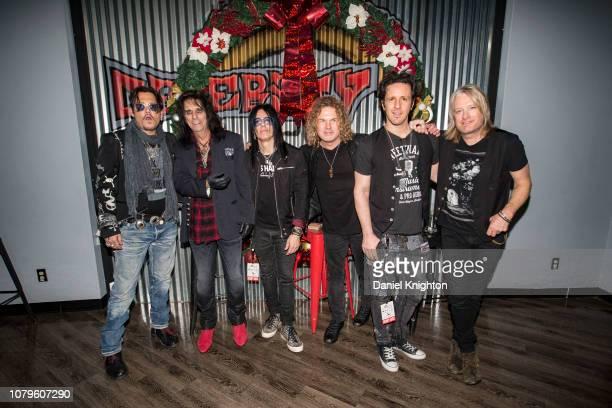 Musicians Johnny Depp Alice Cooper Tommy Henriksen Buck Johnson Glen Sobel and Chris Wyse of Hollywood Vampires pose backstage at the Celebrity...