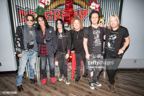 Musicians Johnny Depp Alice Cooper Tommy Henrikson Buck Johnson Glen Sobel and Chris Wyse of Hollywood Vampires pose backstage at Celebrity Theatre...