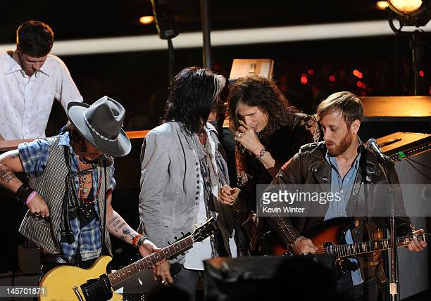 Musicians Johnny Depp Joe Perry Steven Tyler and Dan Auerbach from the Black Keys speak onstage during the 2012 MTV Movie Awards held at Gibson...