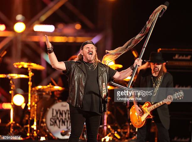 Musicians Johnny Van Zant and Gary Rossington of Lynyrd Skynyrd perform onstage during Spike's Rock the Troops event held at Joint Base Pearl Harbor...