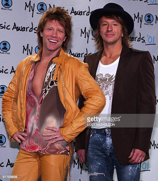 US musicians Jon Bon Jovi and Richie Sambora of the group Bon Jovi pose backstage after winning Hottest Live Show at My VH1 Awards '01 at the Shrine...