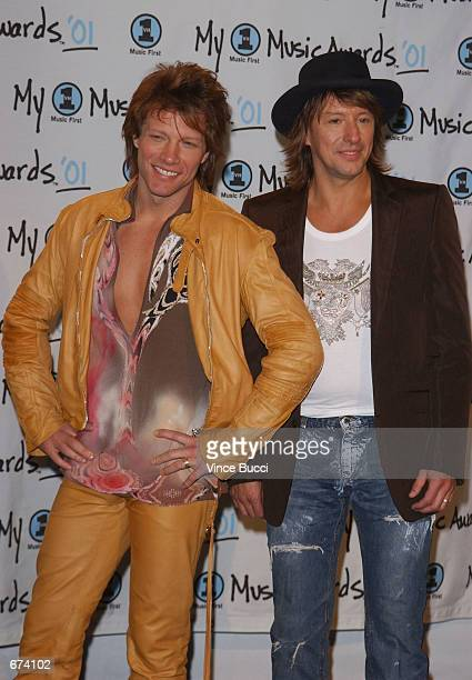Musicians Jon Bon Jovi and Richie Sambora pose backstage during the My VH1 Music Awards at the Shrine Auditorium December 2 2001 in Los Angeles CA