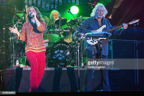 Musicians Jon Davison Alan White and Chris Squire perform on stage with Yes on August 18 2014 in San Diego California