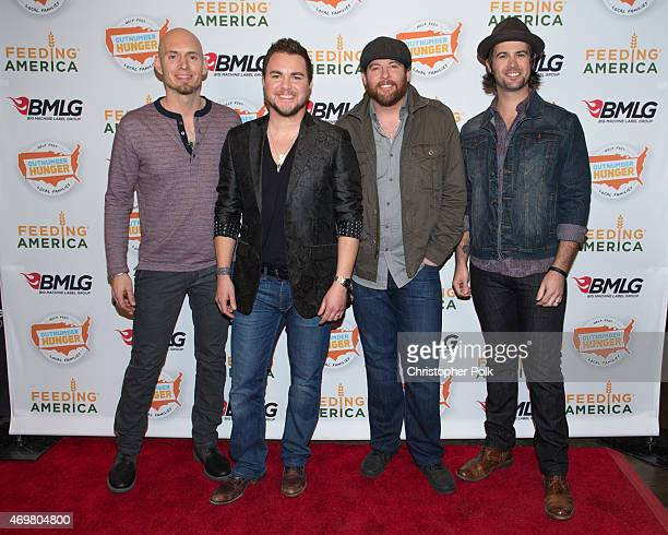 Musicians Jon Jones Mike Eli James Young and Chris Thompson of the Eli Young Band pose at the 'Reba and Friends Outnumber Hunger' concert event on...