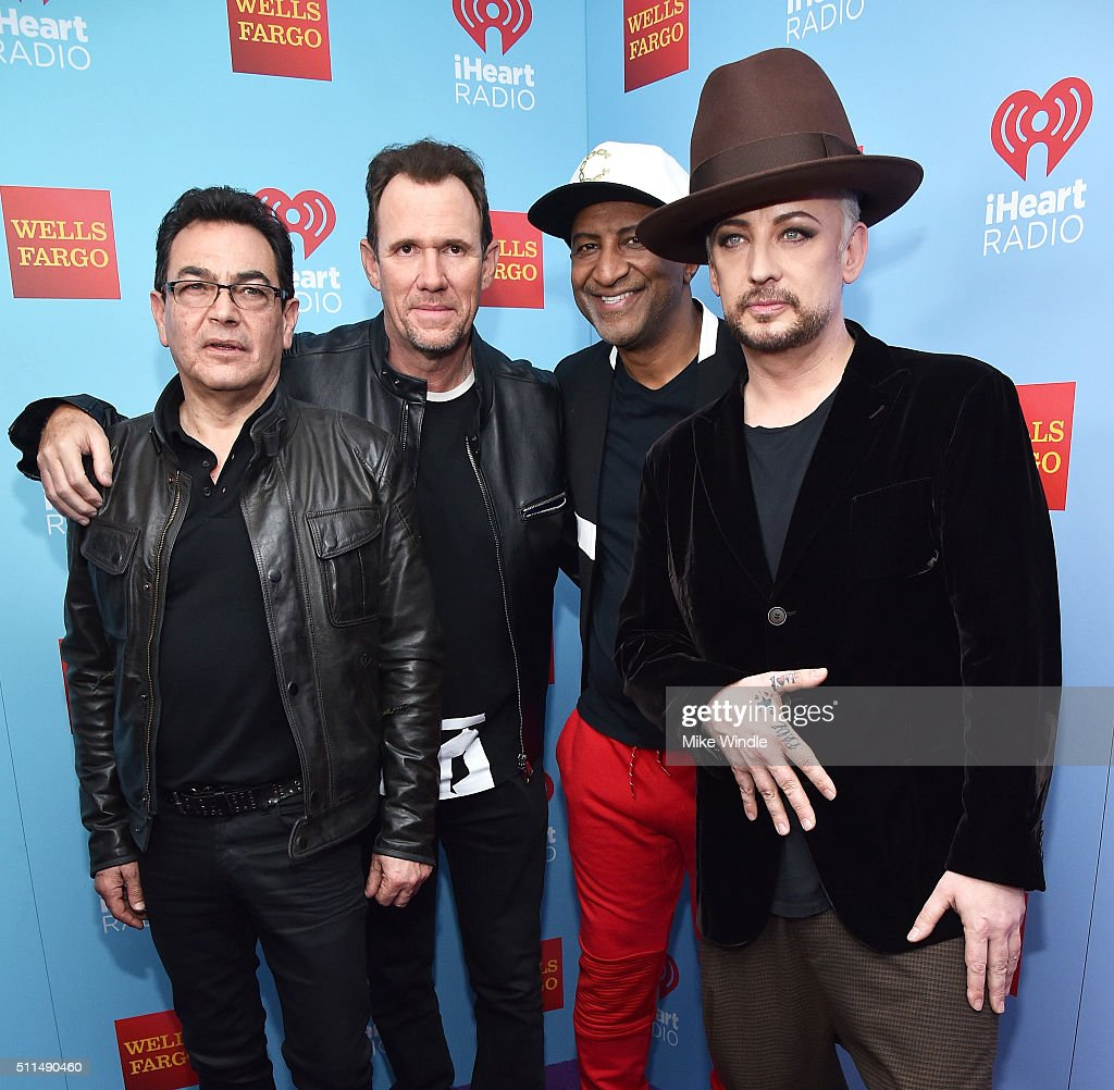 Musicians Jon Moss, Roy Hay, Mikey Craig and Boy George of Culture Club pose backstage during the first ever iHeart80s Party at The Forum on February 20, 2016 in Inglewood, California.