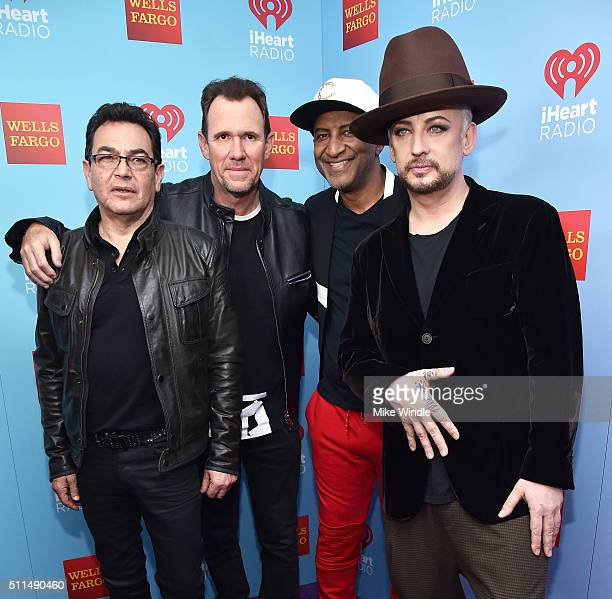 Musicians Jon Moss Roy Hay Mikey Craig and Boy George of Culture Club pose backstage during the first ever iHeart80s Party at The Forum on February...