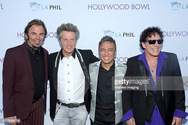 Musicians Jonathan Cain and Ross Valory singer Arnel Pineda and musician Neal Schon of Journey attend Hollywood Bowl Opening Night 2015 at the...