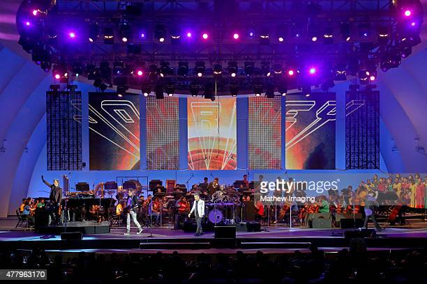 Musicians Jonathan Cain and Ross Valory singer Arnel Pineda and musician Neal Schon of Journey perform onstage during Hollywood Bowl Opening Night...