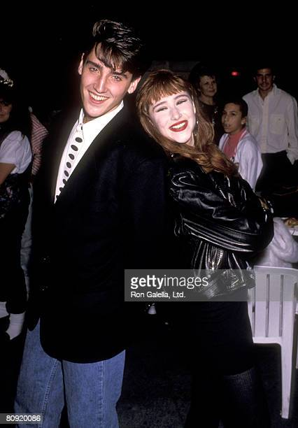 Musicians Jonathan Knight and Tiffany attend Tiffany's 18th Birthday Party on October 8 1989 at Mel's Diner in Universal City California