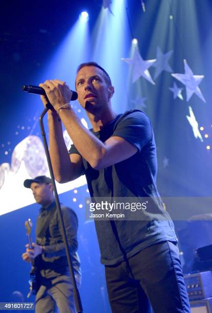 Musicians Jonny Buckland and Chris Martin of Coldplay perform onstage during their iHeartRadio Album Release Party at the iHeartRadio Theater Los...