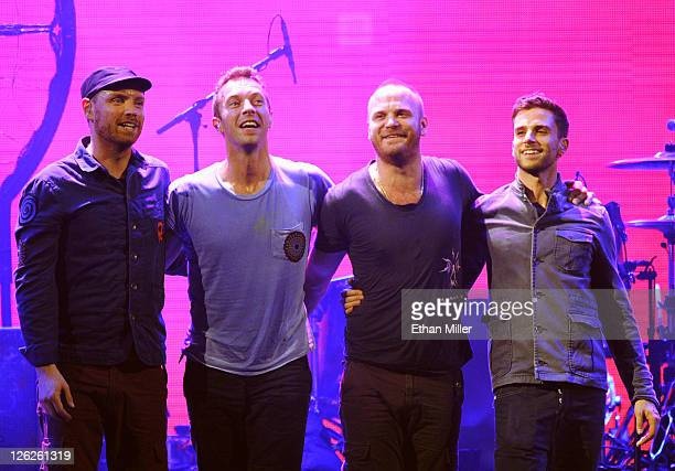 Musicians Jonny Buckland Chris Martin Will Champion and Guy Berryman of the band Coldplay pose onstage at the iHeartRadio Music Festival held at the...