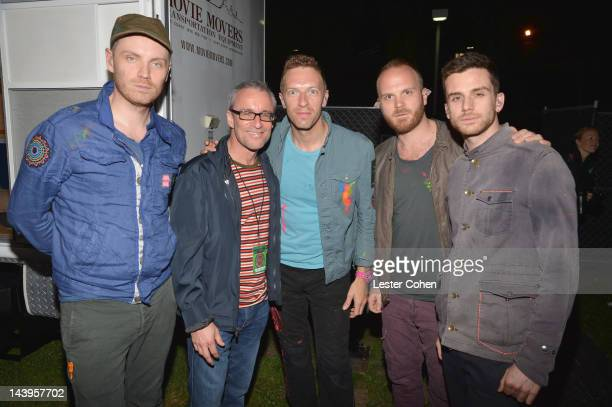 Musicians Jonny Buckland Chris Martin Will Champion and Guy Berryman of the band Coldplay and vice president of programming at KROQ Kevin Weatherly...