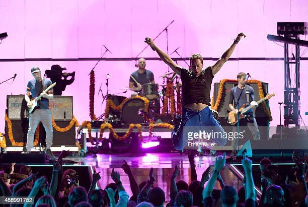 Musicians Jonny Buckland Will Champion Chris Martin and Guy Berryman of Coldplay perform onstage at the 2015 iHeartRadio Music Festival at MGM Grand...