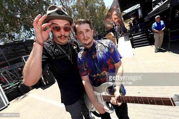 Musicians Jordan Kelley and Jason Huber of Cherub pose backstage during the 22nd Annual KROQ Weenie Roast at Verizon Wireless Music Center on May 31...