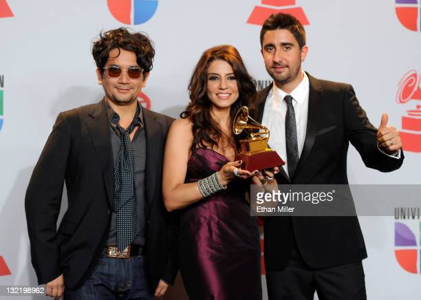 Musicians Jorge Villamizar Lena Burke and Alex Ubago of the band Alex Jorge y Lena pose with the Best Pop Album by a Duo/Group with Vocals Award in...