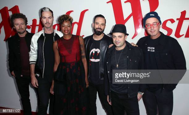 Musicians Joseph Karnes Michael Fitzpatrick Noelle Scaggs Jeremy Ruzumna James King and John Wicks of Fitz and the Tantrums attend the grand opening...