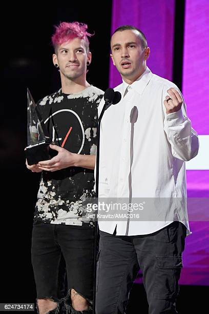 Musicians Josh Dun and Tyler Joseph of Twenty One Pilots accept Favorite Pop/Rock Band/Duo/Group onstage at the 2016 American Music Awards at...