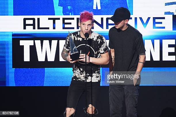 Musicians Josh Dun and Tyler Joseph of Twenty One Pilots accept Favorite Pop/Rock Band/Duo/Group onstage during the 2016 American Music Awards at...