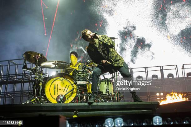 Musicians Josh Dun and Tyler Joseph of Twenty One Pilots perform on stage at Pechanga Arena on November 05 2019 in San Diego California