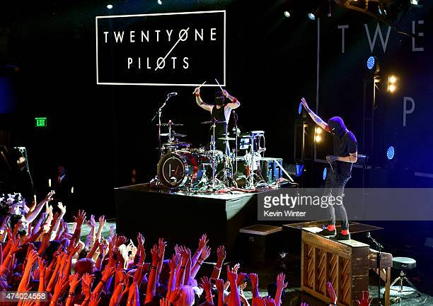 Musicians Josh Dun and Tyler Joseph of Twenty One Pilots perform onstage during the iHeartRadio Live Series with Twenty One Pilots at the iHeartRadio...
