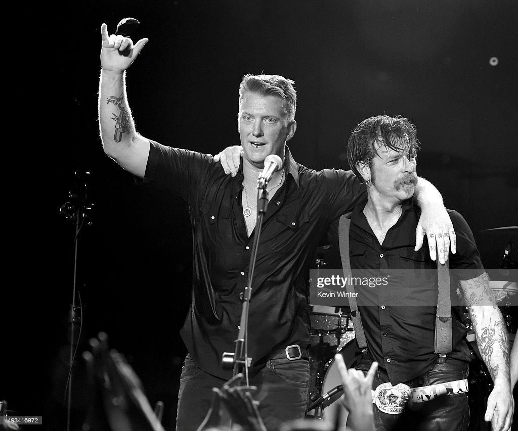 Musicians Josh Homme (L) and Jesse Hughes of Eagles of Death Metal perform at the Teragram Ballroom on October 19, 2015 in Los Angeles, California.