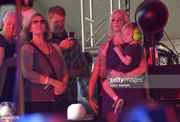 Musicians Josh Homme Brody Dalle and son Orrin Ryder Homme are seen backstage during day 2 of the 2014 Coachella Valley Music Arts Festival at the...
