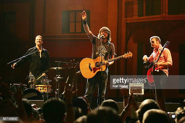 Musicians Josh Homme of Queens Of The Stone Age Dave Grohl of The Foo Fighters and Jesse Hughes of The Eagles of Death Metal perform during the...