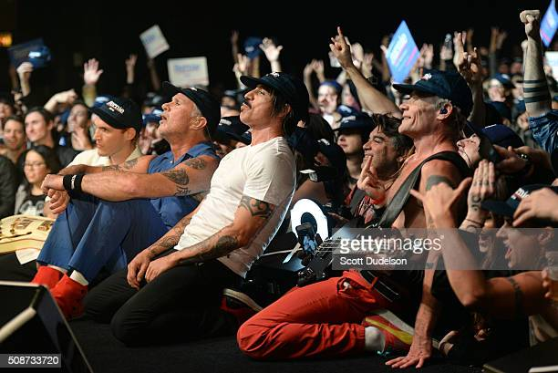 Musicians Josh Klinghoffer Chad Smith Anthony Kiedis and Flea of the Red Hot Chili Peppers pose with fans onstage during the 'Feel the Bern'...