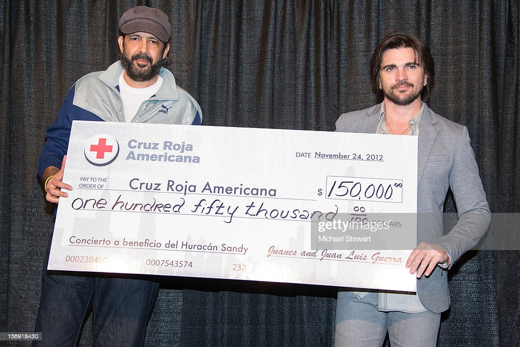 Musicians Juan Luis Guerra (L) and Juanes attend the Hurricane Sandy Benefit concert at the Barclays Center on November 24, 2012 in the Brooklyn borough of New York City.
