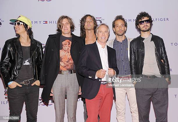 Musicians Julian Casablancas Nikolai Fraiture Nick Valensi designer Tommy Hilfiger and musicians Albert Hammond Jr and Fabrizio Moretti of the...