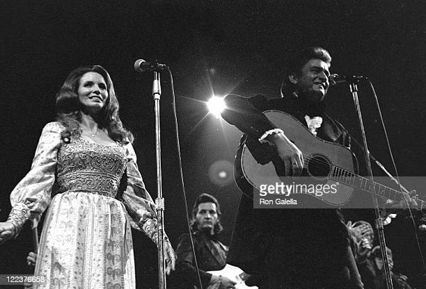 Musicians June Carter Cash and Johnny Cash perform in concert on December 4 1970 at Madison Square Garden in New York City
