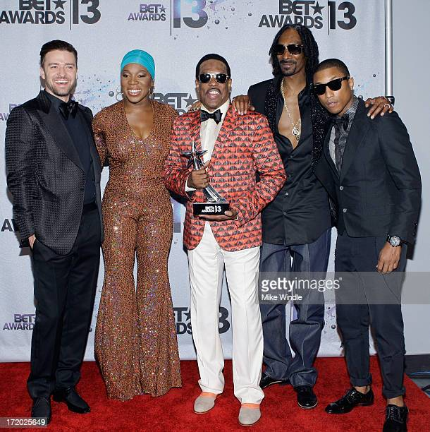 Musicians Justin Timberlake IndiaArie BET Lifetime Achievement Award recipient musician Charlie Wilson rapper Snoop Lion and Pharrell Williams in the...
