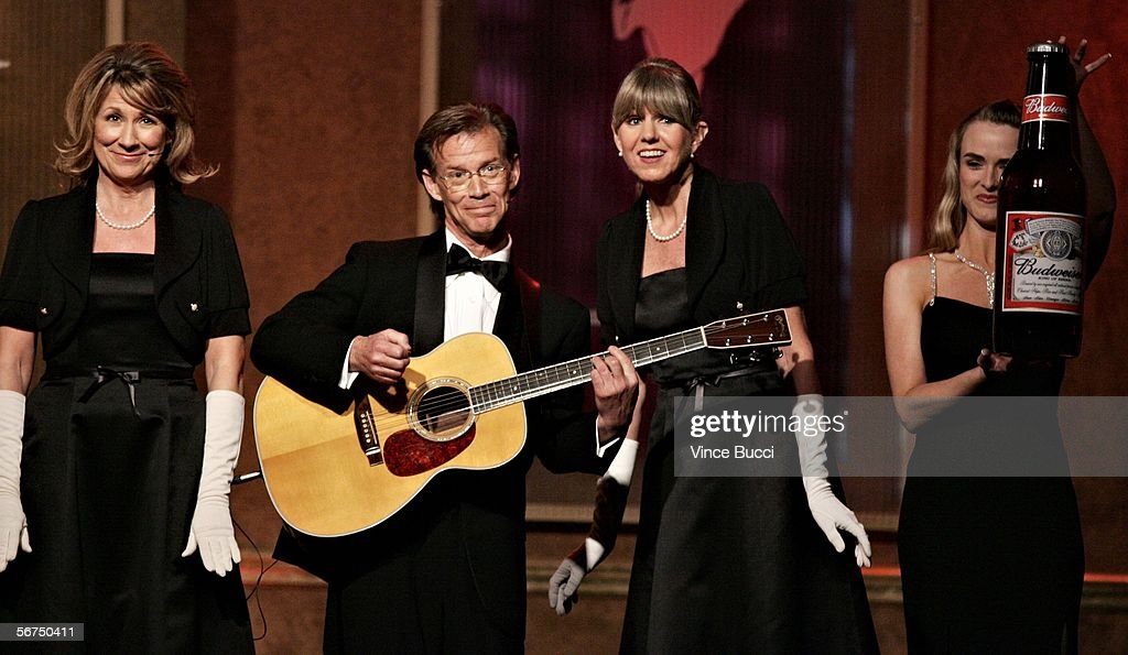 Musicians Kathy Coon, Steve Coon and Mandi Stanley of the band 'Scambooty' perform the 'Budweiser Long Form Adapted' song onstage during the 2006 Writers Guild Awards held at The Hollywood Palladium on February 4, 2006 in Hollywood, California.