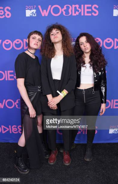 Musicians Katie Gavin Naomi McPherson and Josette Maskin of MUNA pose at MTV Woodies LIVE on March 16 2017 in Austin Texas