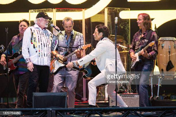 Musicians Keith Hubacher, Mike Love, Christian Love, John Stamos, and Scott Totten of The Beach Boys perform on stage at PETCO Park on May 29, 2021...