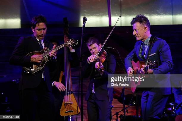 Musicians Keith Sewell Luke Bulla and Lyle Lovett perform at the Annenberg Space for Photography Opening Celebration for Country Portraits of an...