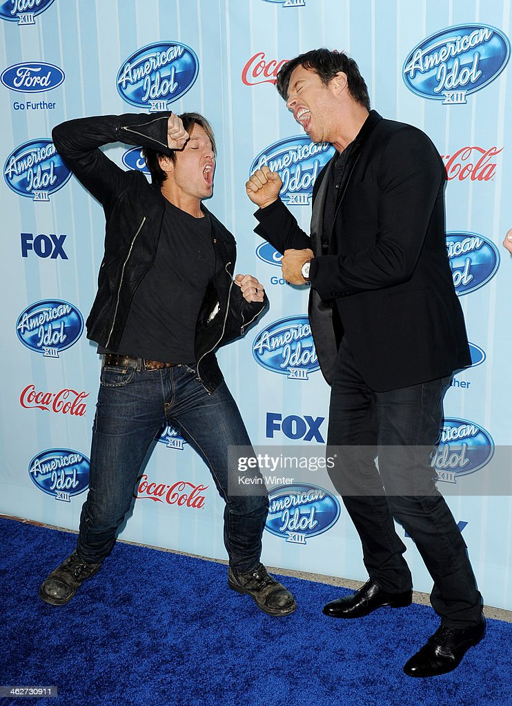 Musicians Keith Urban (L) and Harry Connick Jr. arrive at the premiere of Fox's 'American Idol Xlll' at UCLA's Royce Hall on January 14, 2014 in Los Angeles, California.