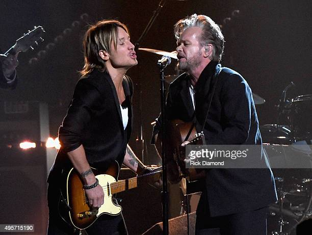 Musicians Keith Urban and John Mellencamp perform onstage at the 49th annual CMA Awards at the Bridgestone Arena on November 4 2015 in Nashville...