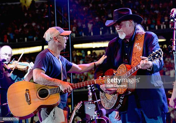 Musicians Kenny Chesney and Ray Benson of Asleep at the Wheel perform onstage at George Strait's 'The Cowboy Rides Away Tour' final stop at ATT...