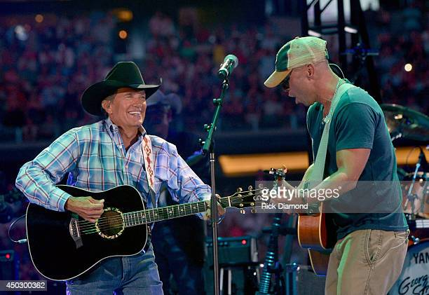 Musicians Kenny Chesney performs Ocean Front Property and The Fireman with George Strait onstage at George Strait's 'The Cowboy Rides Away Tour'...