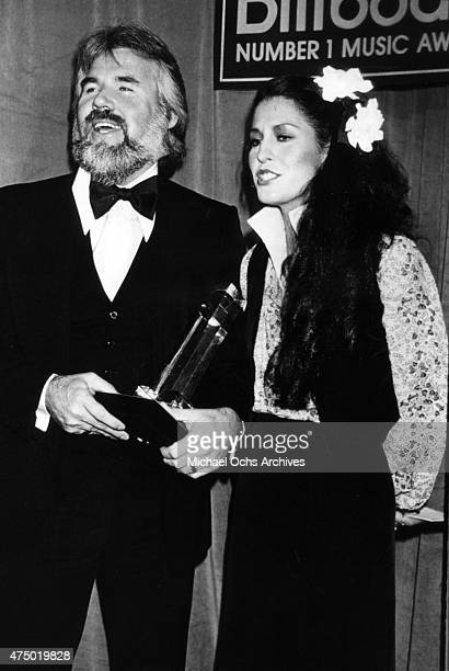Musicians Kenny Rogers and Rita Coolidge pose for a portrait backstage at the Billboard Music Awards in circa 1977 in Los Angeles California