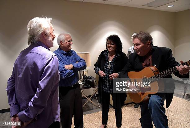 Musicians Kenny Rogers Mike Settle Mary Arnold Miller and Terry Williams perform backstage during a panel discussion with Kenny Rogers and the First...