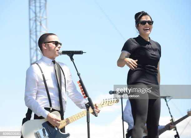 Musicians Kevin Bivona and Aimee Allen of the band The Interrupters perform onstage during the Its Not Dead 2 Festival at Glen Helen Amphitheatre on...