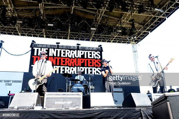 Musicians Kevin Bivona Jesse Bivona Aimee Allen and Justin Bivona of the band The Interrupters perform onstage during the Its Not Dead 2 Festival at...