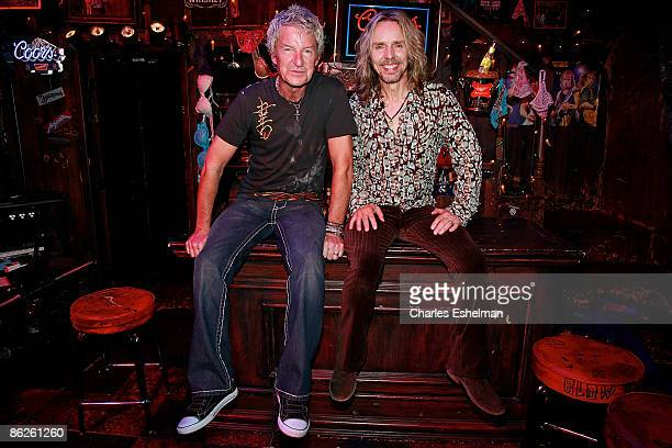 Musicians Kevin Cronin and Tommy Shaw perform during the Rock of Ages curtain call at the Brooks Atkinson Theatre on April 27 2009 in New York City