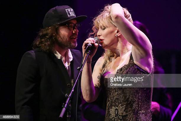 Musicians Kevin Drew and Courtney Love perform at a celebration of the 60th anniversary of Allen Ginsberg's Howl with music words and funny people at...