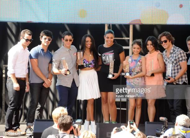 Musicians Kevin Jonas Joe Jonas and Nick Jonas actress Kat Graham singer/actress Jordin Sparks and actors Sarah Hyland and Vanessa Hudgens and Diego...
