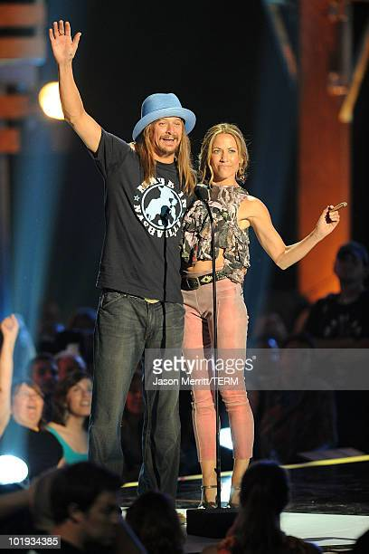 Musicians Kid Rock and Carrie Underwood onstage at the 2010 CMT Music Awards at the Bridgestone Arena on June 9 2010 in Nashville Tennessee