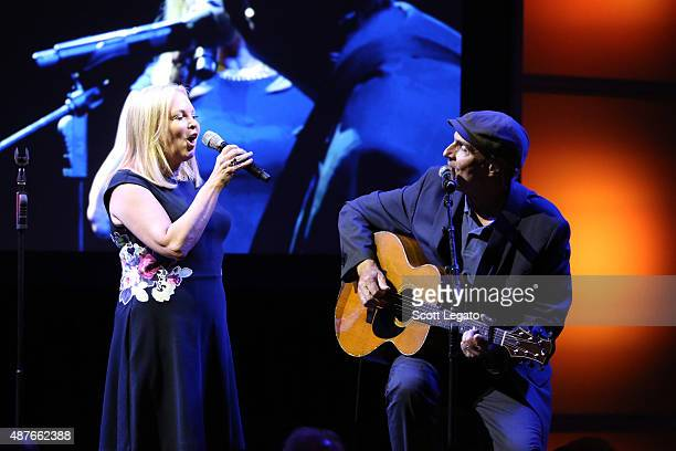 Musicians Kim Taylor and James Taylor perform onstage at the USC Shoah Foundation Ambassadors for Humanity Gala honoring William Clay Ford, Jr. At...