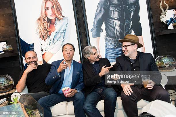 Musicians Kinan Azmeh YoYo Ma Kayhan Kalhor and producer Morgan Neville attend the Guess Portrait Studio at the Toronto International Film Festival...